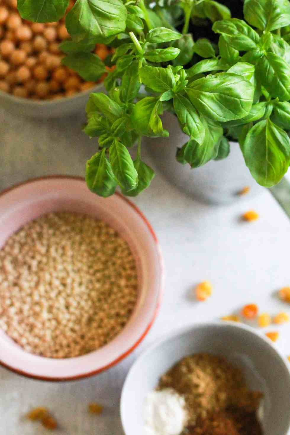 Fresh basil, dry couscous, chickpeas, and spices.