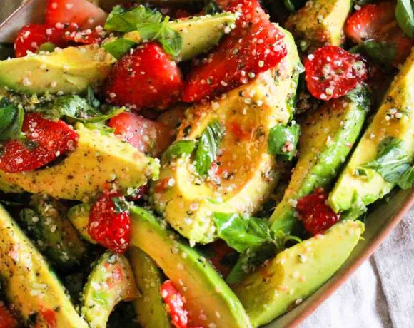Strawberry Avocado Salad on beige platter with hemp hearts.