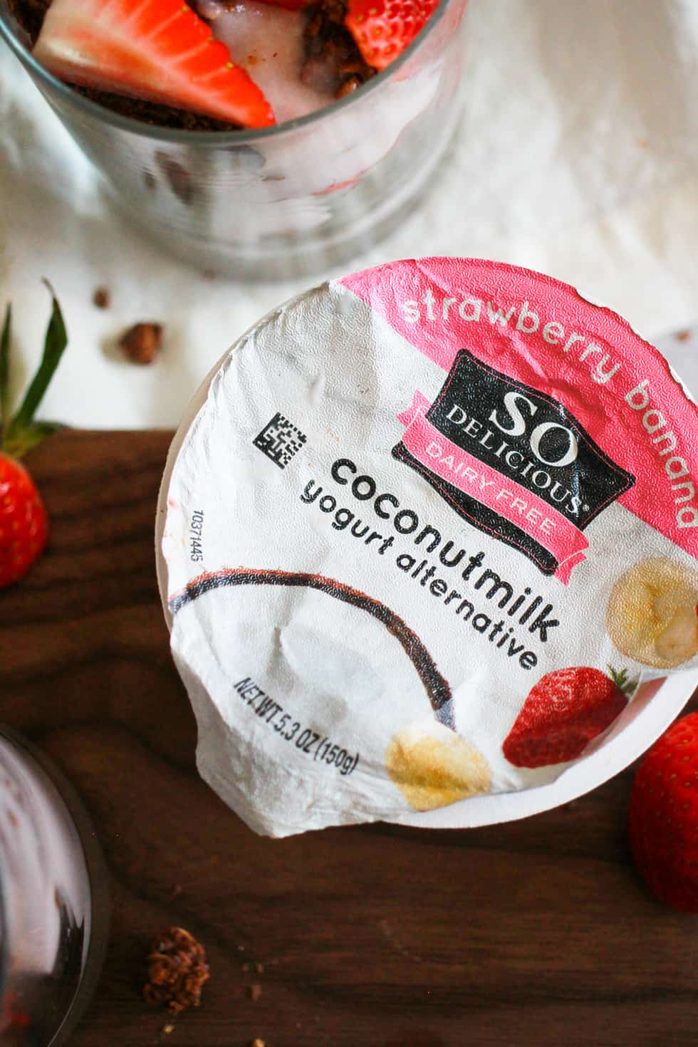 Carton of So Delicious strawberry banana yogurt alternative.