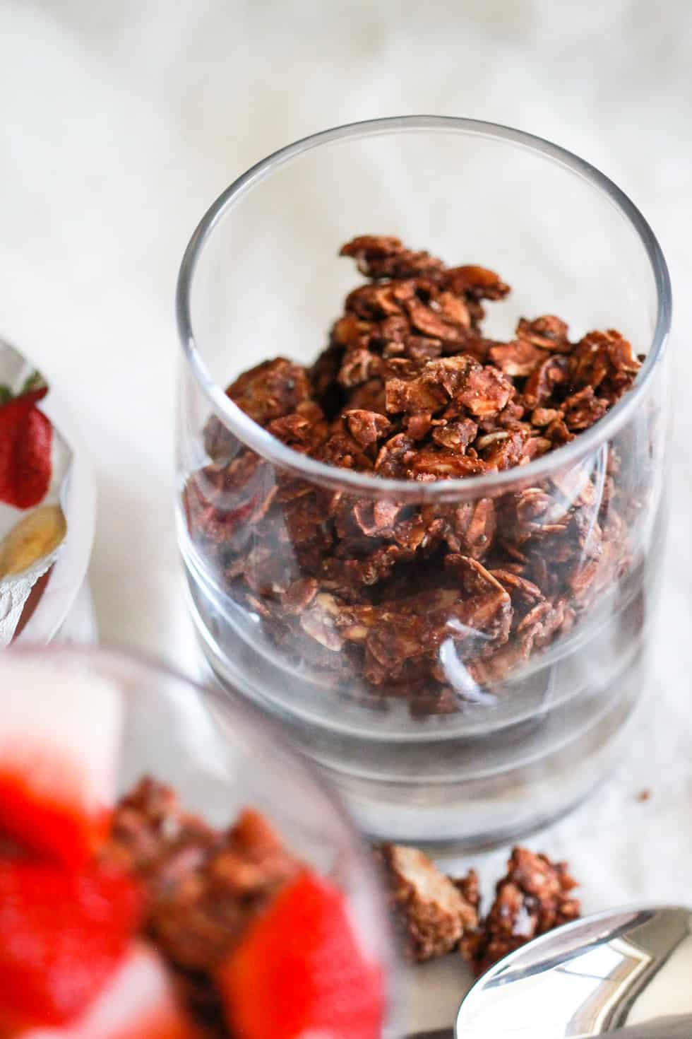 Chocolate chia seed granola in a glass.
