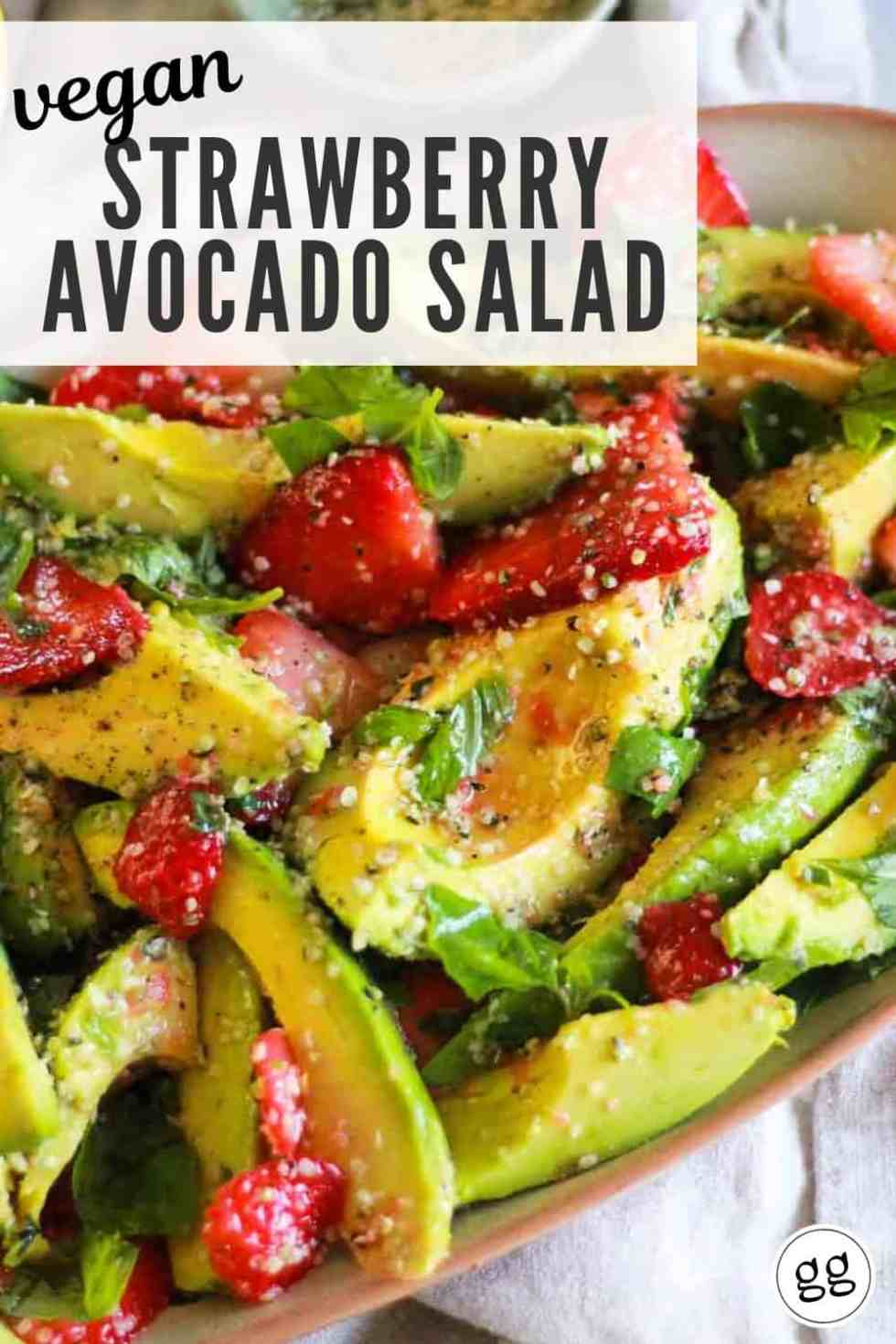 "Avocado and berry salad on platter with text that reads, ""Vegan Strawberry Avocado Salad."""