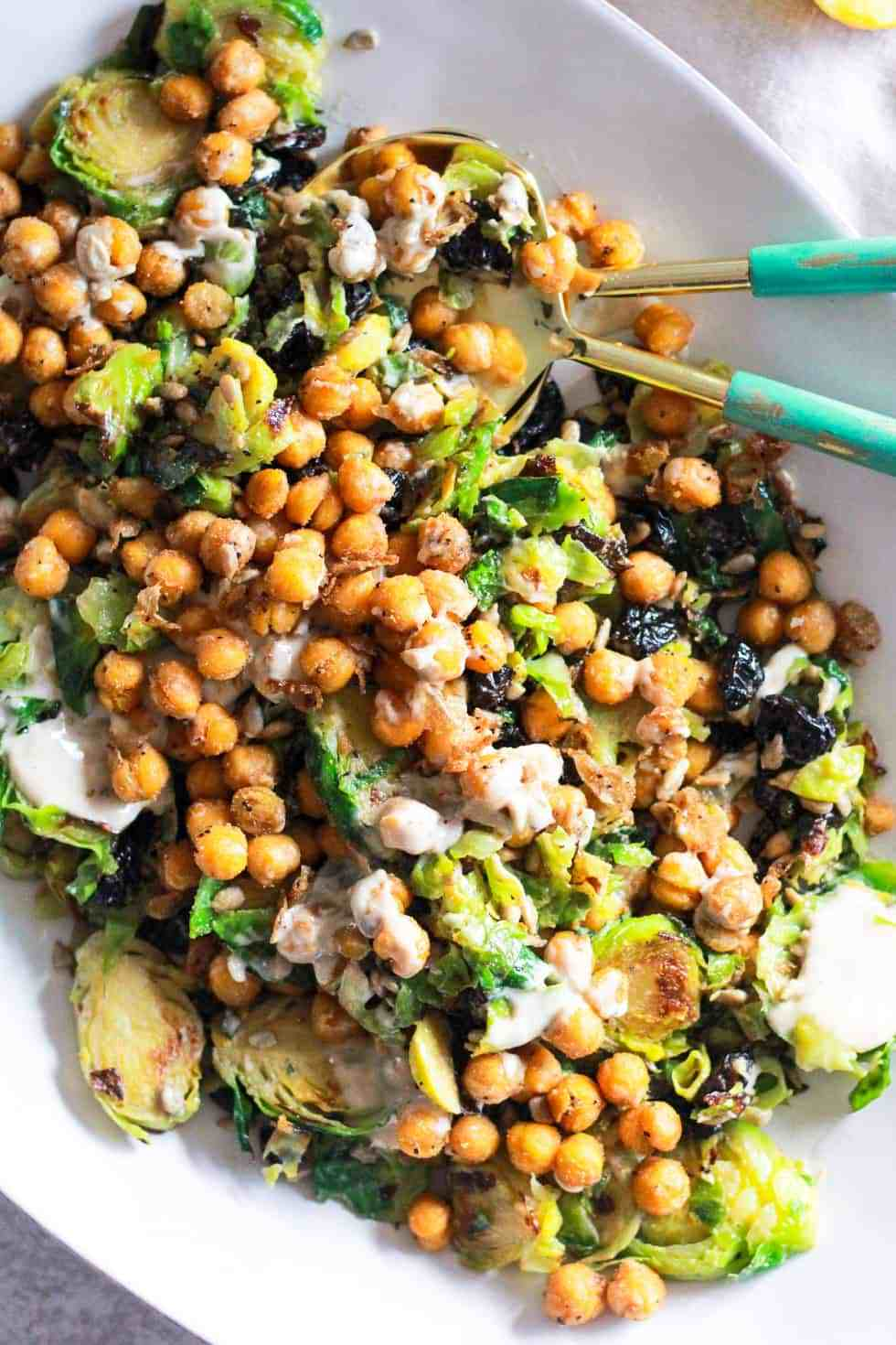 Chickpea salad with brussels sprouts on a white platter is an easy college meal