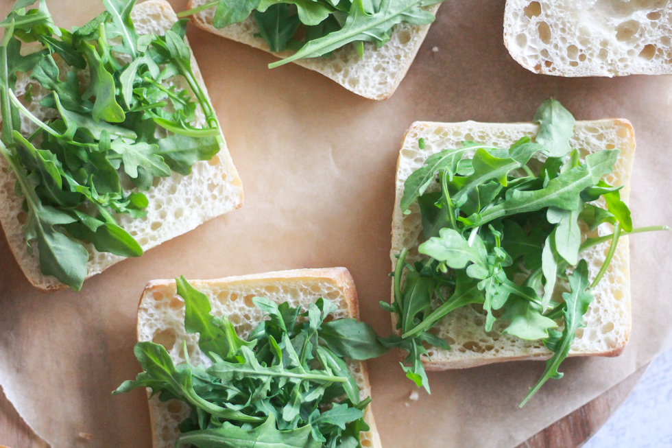 Open faced sandwich with baby arugula