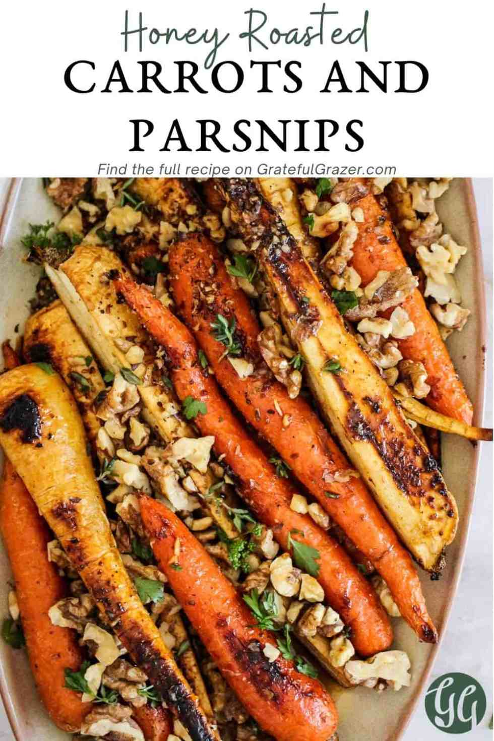 "Roasted vegetables with nuts and parsley on beige ceramic platter with text reading, ""Honey Roasted Carrots and Parsnips - find the full recipe on GratefulGrazer.com."""