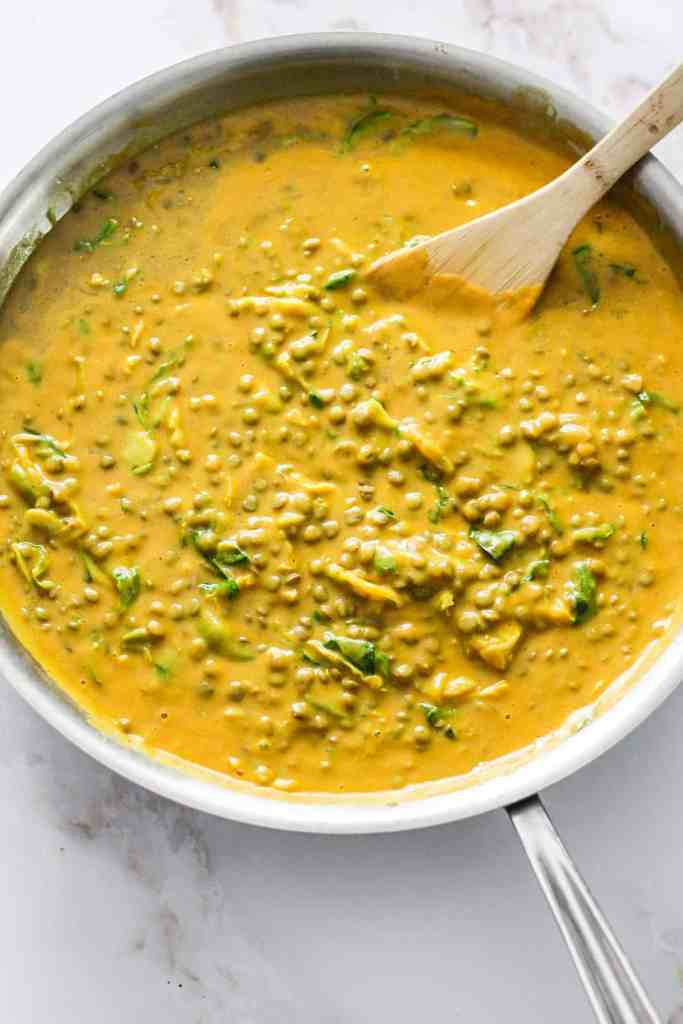Yellow butternut squash curry in an aluminum skillet.