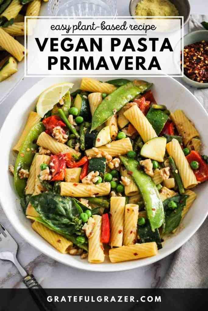 "Vegetable rigatoni in a white bowl with text reading ""Easy Plant-Based Recipe: Vegan Pasta Primavera; GratefulGrazer.com."""