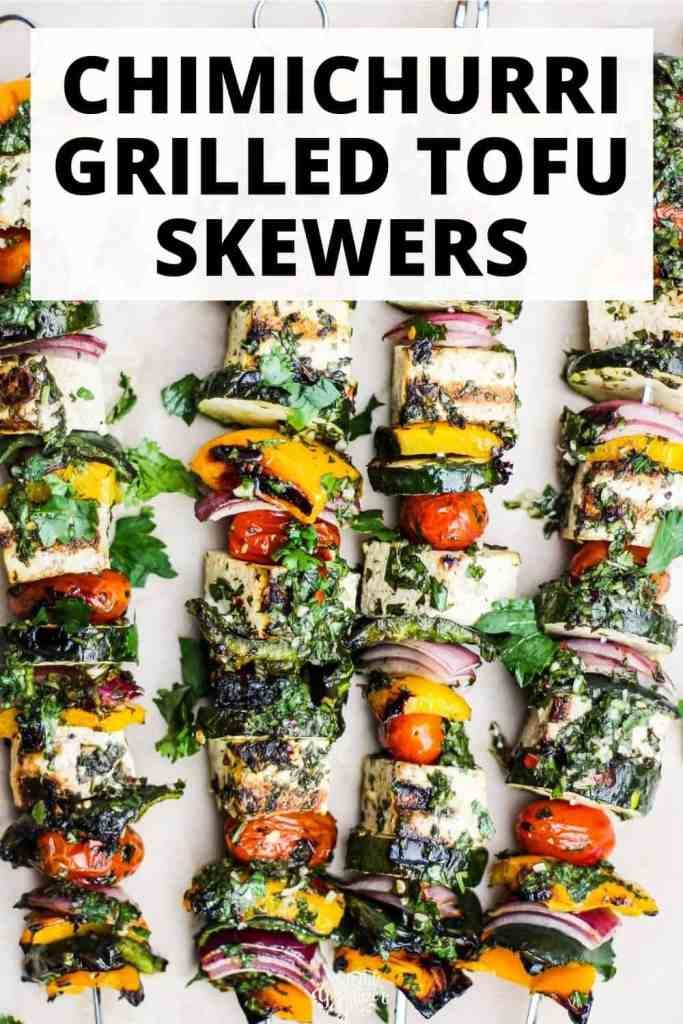"""Tofu and vegetable skewers with green sauce and text reading, """"Chimichurri Grilled Tofu Skewers."""""""