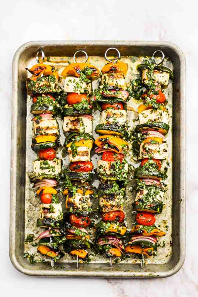 Baking sheet with grilled tofu and vegetable kebabs.
