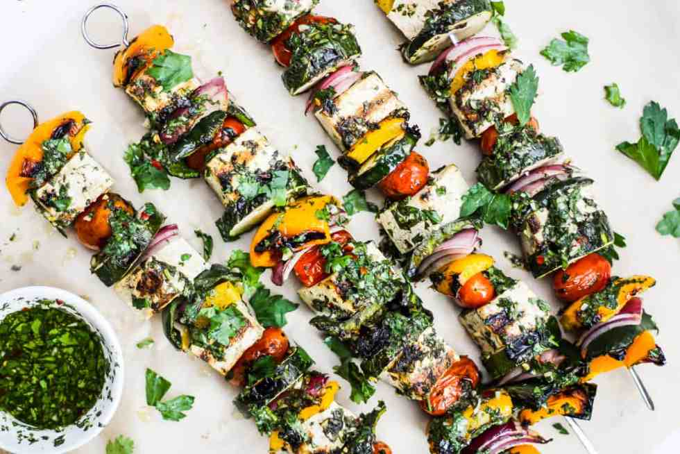 Horizontal overhead image of tofu kebabs on parchment paper.