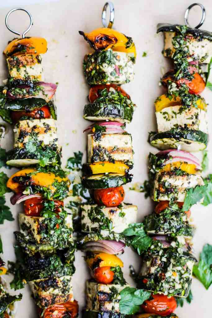 Chimichurri Grilled Tofu and Vegetable Skewers on parchment paper.