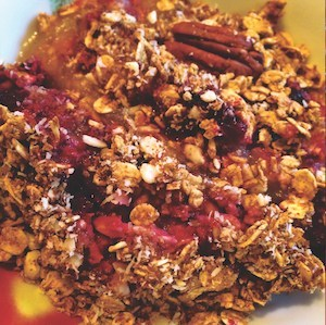 An image of this apple and cherry crumble recipe, in a bowl.
