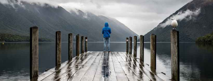 Young boy standing at the top of a pier