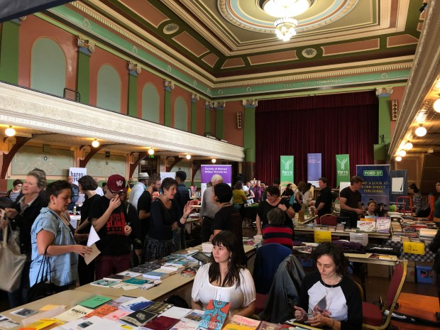 The GSP's stall at Fitzroy Writers Festival Bookseller's Marketplace packed full of people.
