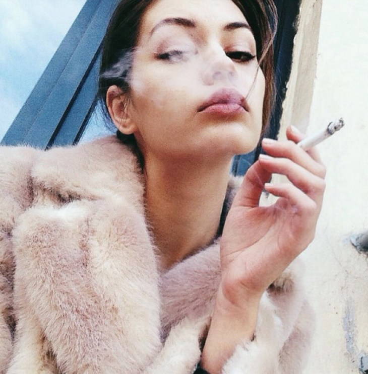 Vintage fur and a lil cig yo