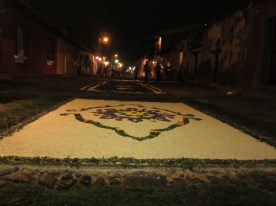 A completed alfombra at night, to be walked on in a couple of hours