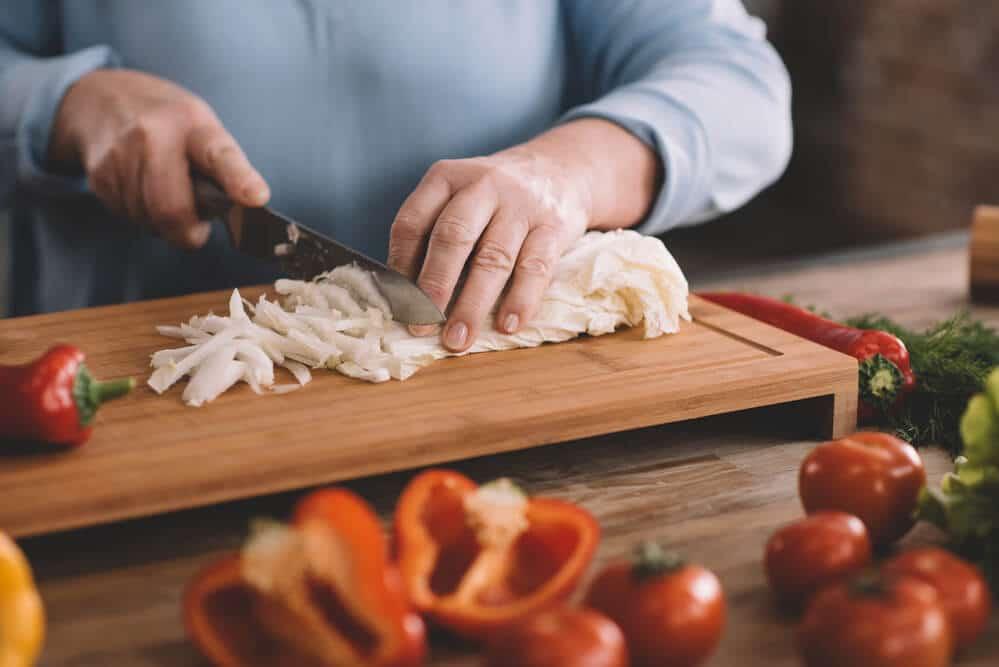 senior woman chopping vegetables