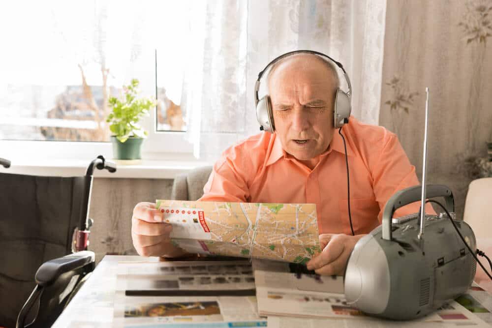 old man listening to radio