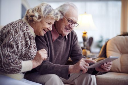 senior couple shopping online for the best lift chair