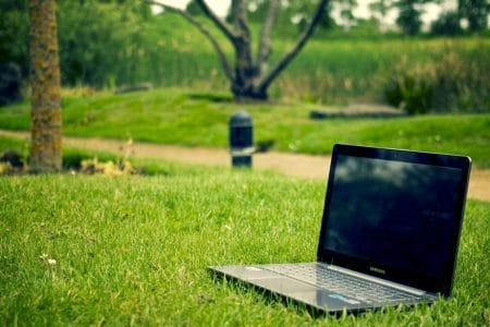 laptop computer in the grass