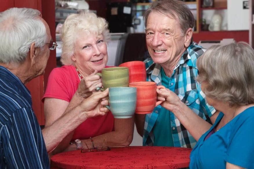 group of seniors drinking from lightweight coffee mugs