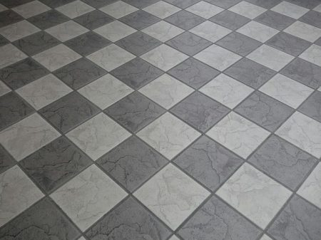 gray and white ceramic tiles in a checkerboard pattern.