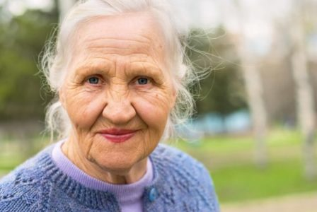smiling elderly woman at the park
