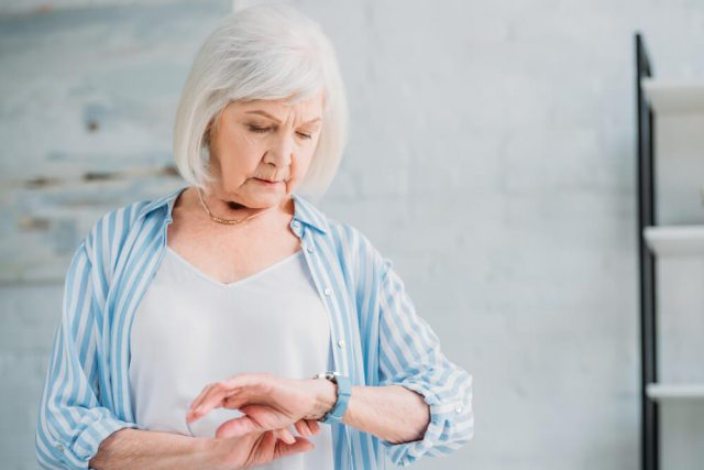 senior lady looking at easy to read watches for seniors