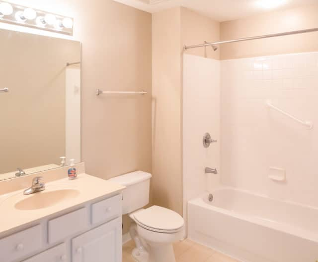 bathroom showing a large shower and tub combo