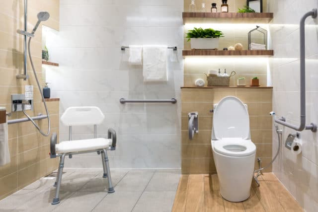 disabled bathroom with a large walkin shower