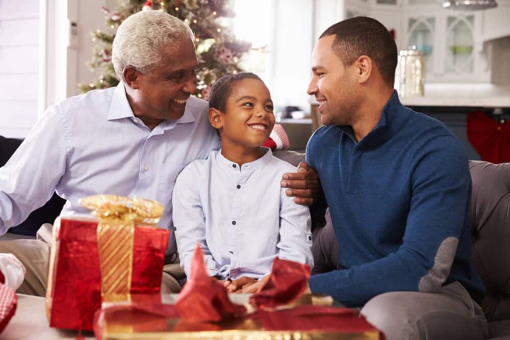 grandson giving grandfather inexpensive gift