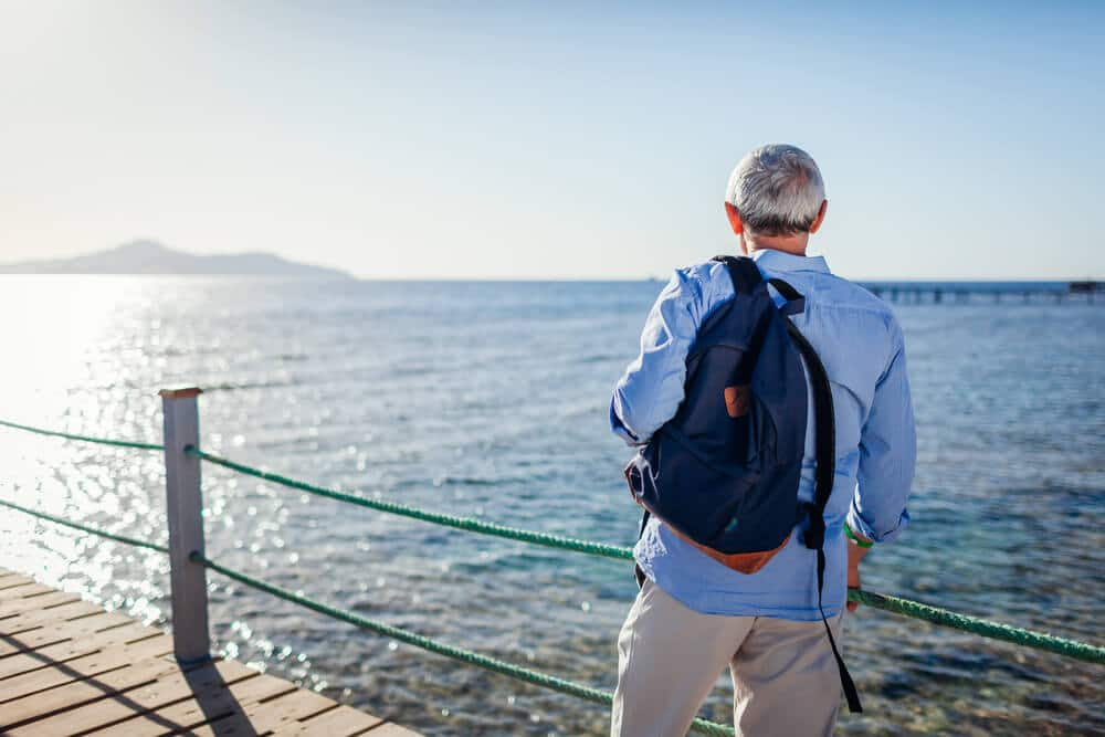 senior man traveling alone