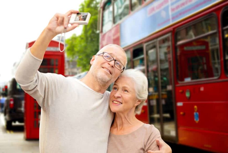 senior couple taking a selfie on their European vacation in London