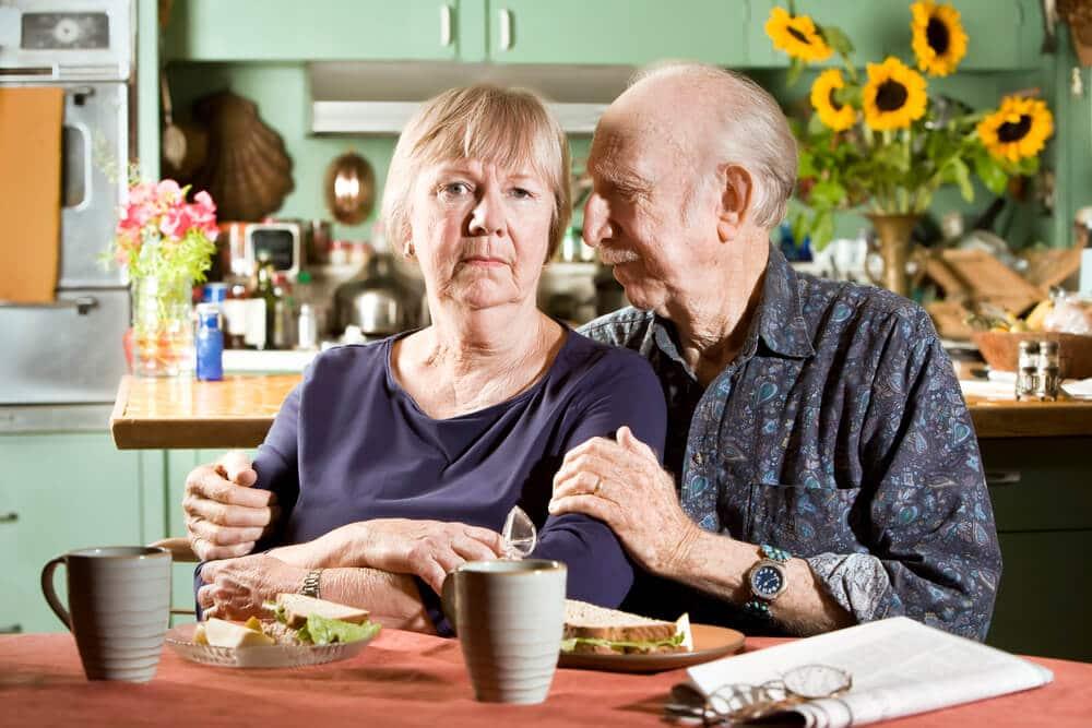 senior couple wearing GPS tracker watches