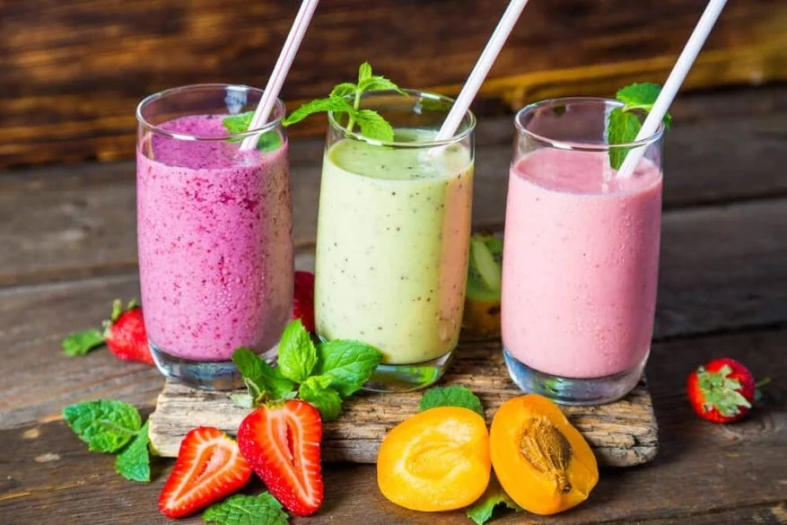 high calorie fruit smoothies in various colors with straws