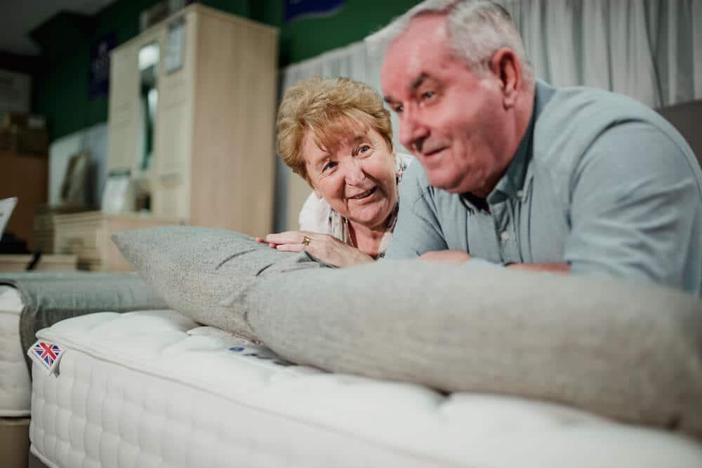 senior couple shopping for a new mattress