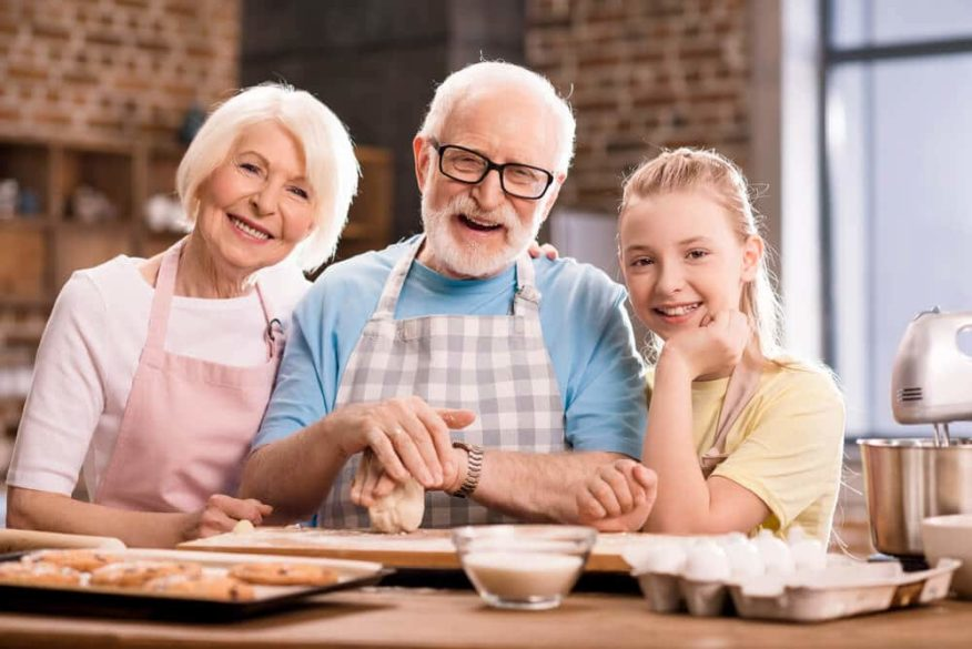seniors in kitchen with granddaughter