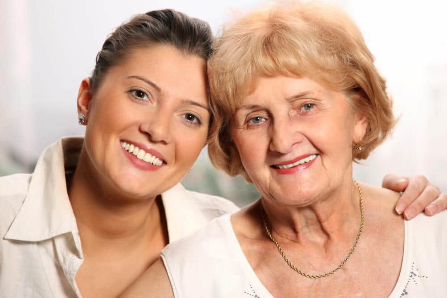 woman smiling with her granddaughter