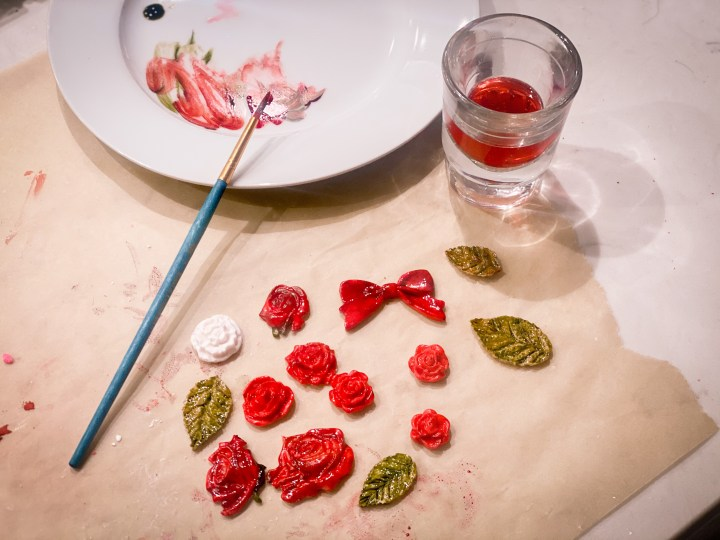 pictures of gum paste flowers being painted with food coloring