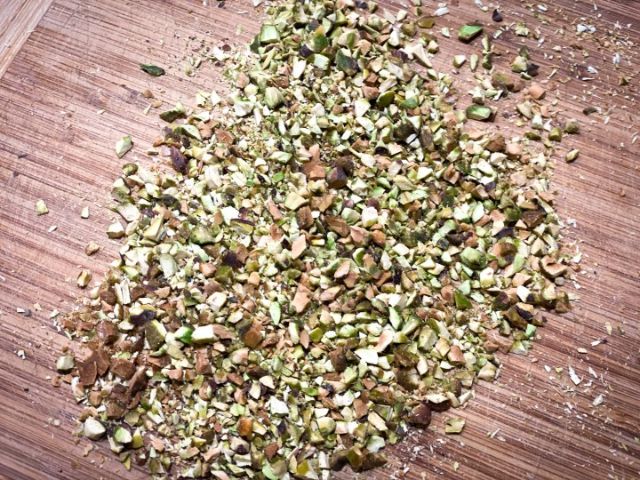 Picture of chopped pistachios to be used for Chocolate-Dipped Peanut Butter Stuffed Dates