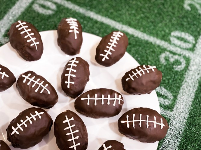 chocolate peanut butter footballs on a plate.