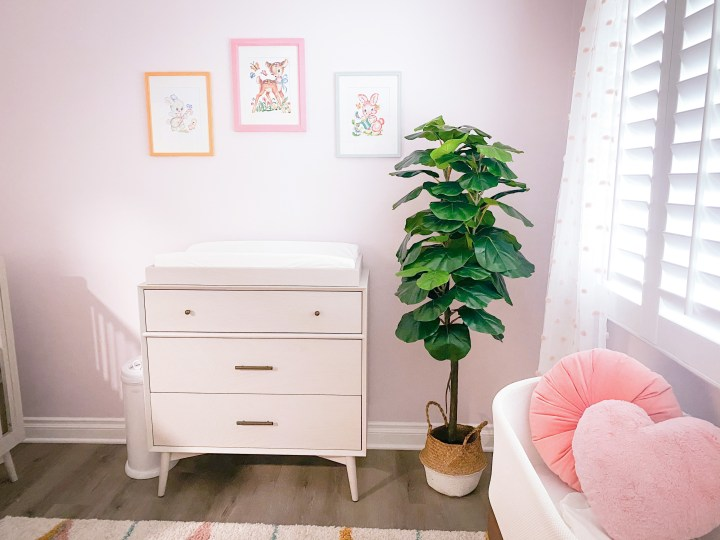 baby girl pink nursery with dresser and snoo
