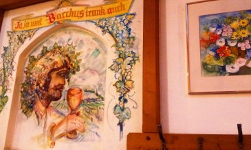The nice folklore on the wall inside the Buschenschank