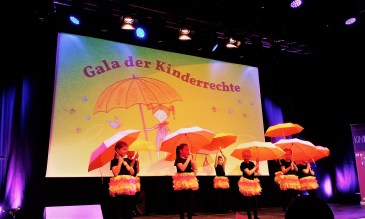 A playful performance with umbrellas