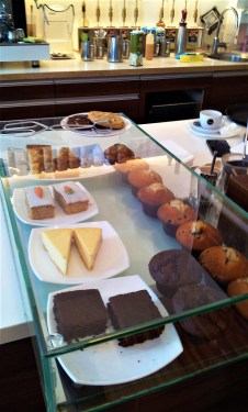 The cakes and muffins in the showcase