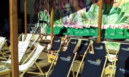 The many beach chairs and the sofa bench in the rear