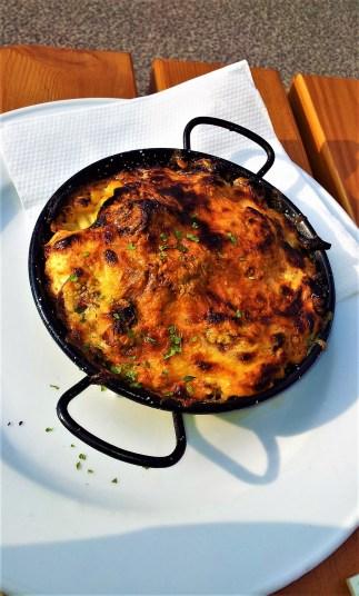The yummy spaetzle pan (Pfandl) with feta, beans, salami and corn