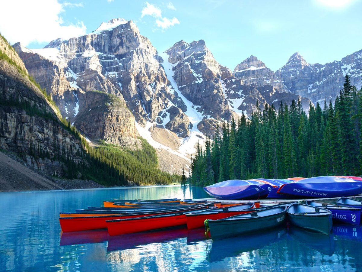 Canoes piled on the dock at the end of the day. Moraine Lake, Banff