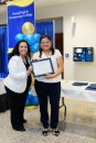 Lorena Aguayo-Marquez stands next to a woman holding a certificate.