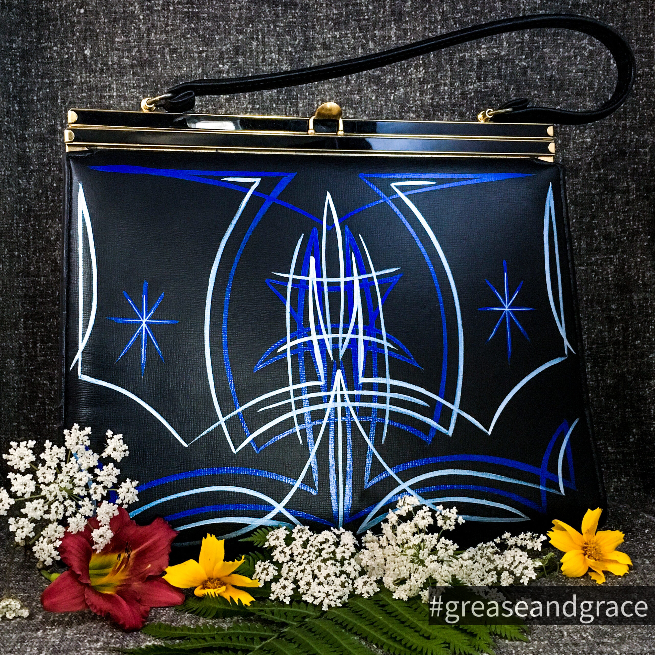 Vintage pinstriped handbag, black with electric blue and ice blue designs.
