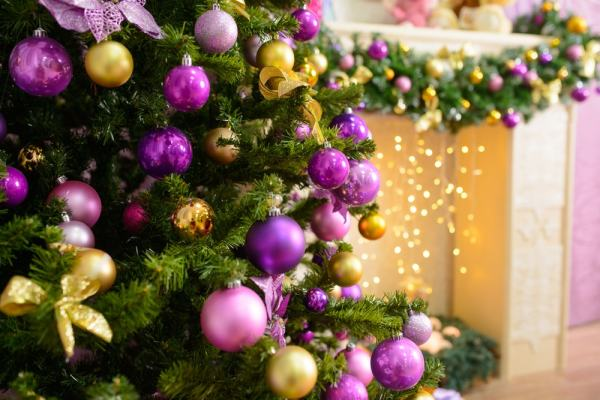 Purple and gold glass balls on a Christmas tree